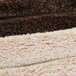 Photo of layers of brown and beige carpeting