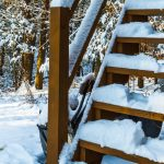 Stairs covered snow house in suburbs in winter time